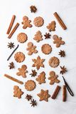 Christmas composition - gingerbread cookie, anise and cinnamon on wooden table. Gingerbread cookies and spices over white background close up stock photos