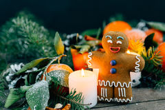 Christmas composition with gingerbread man Tangerines, Pine cones, Walnuts and Candles on Wooden Background, holiday decoration Stock Photography