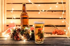 Christmas composition with a glass of beer royalty free stock images