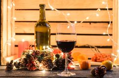 Christmas composition with a glass of red wine royalty free stock photo