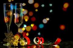 Christmas composition with a glass of sparkling wine. Christmas composition with a glass of sparkling wine, Christmas decorations and cork, on a dark background stock image