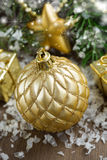 Christmas composition with golden ball and bokeh Royalty Free Stock Photography