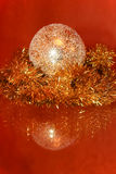 Christmas composition. Golden sphere and tinsel are reflect in t Stock Photo