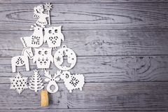 Christmas composition on a gray background. Christmas tree composed of wooden Christmas decorations. Top view, free space. Christmas composition on a gray wooden Stock Photos