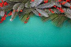 Christmas composition. Christmas green decorations, fir tree branches with bumps on green background. Flat lay, top view. Copy space stock photos