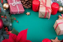 Christmas composition. Christmas green decorations, fir tree branches with toys gift boxes on green background. Flat lay. Top view, copy space royalty free stock photos