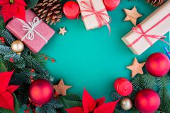 Christmas composition. Christmas green decorations, fir tree branches with toys gift boxes on green background. Flat lay. Top view, copy space royalty free stock image
