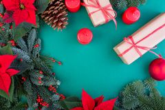 Christmas composition. Christmas green decorations, fir tree branches with toys gift boxes on green background. Flat lay. Top view, copy space royalty free stock photo