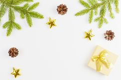 Christmas composition with green fir tree branch, Xmas gifts and decoration on white background. Top view, flat lay Royalty Free Stock Image