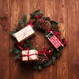 Christmas composition handmade christmas wreath with gift box on. Wooden background Festive concept Top view flat lay Stock Images