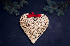 Christmas composition handmade heart on dark background. Xmas and new year concept Top view flat lay Stock Photography