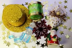 Christmas composition: hat, drum, snowman, heart, snowflake, Santa Claus and stars Stock Photos