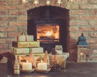 Christmas setting, lantern, decorated fireplace, fur tree Royalty Free Stock Images