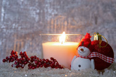 Christmas composition - lighted white candle Royalty Free Stock Image