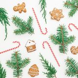 Christmas composition made of gingerbread, winter tree and candy cane on white background. Flat lay. top view. New year concept. Royalty Free Stock Photography