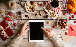 Christmas composition. Man holding tablet. Studio shot. Royalty Free Stock Photos
