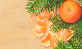 Christmas composition with mandarins and fir tree on wood white Stock Photography