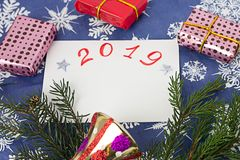 Christmas composition on a New Year`s background,gift and fir branches stock photography