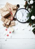 Christmas composition New Year concept clock with xmas gifts swe Royalty Free Stock Photo