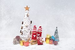 Christmas composition with Noel gnomes and small gifts. Copy space. Holiday symbol royalty free stock image