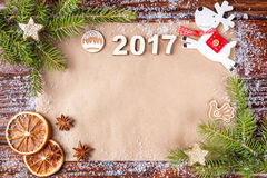 Christmas composition with number of year 2017 on vintage paper in the up of the frame. Royalty Free Stock Photo
