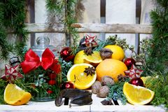 Christmas composition with oranges and spices Stock Images