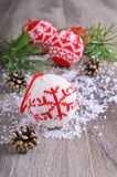 Christmas composition. With ornaments, pine cones, branches of fir trees and artificial snow Stock Photography