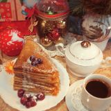 Christmas  composition with pancakes. Christmas breakfast with pancakes, cherry, black coffee, red and gold christmas balls and cones Stock Photo