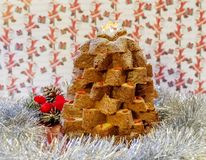 Christmas composition with Pandoro, a typical Italian dessert, cut in a star shape and decorations with Goji berries royalty free stock photos