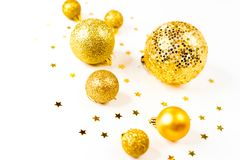 Christmas composition. a pattern of golden christmas balls and stars from above. Flat lay, top view. A pattern of golden christmas balls and stars from aboveFlat Stock Photo