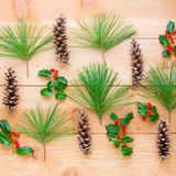 Christmas composition. Pattern of pine cones and branches with h Royalty Free Stock Photography