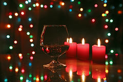 Christmas composition photo cognac glass and candle on black background Royalty Free Stock Photos