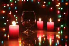 Christmas composition photo cognac glass and candle on black background Royalty Free Stock Images