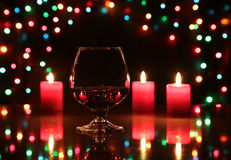 Christmas composition photo cognac glass and candle on black background Stock Photos