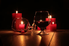 Christmas composition photo cognac glass and candle on black background Stock Images