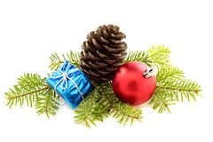 Christmas composition with a pine cone and toys. Royalty Free Stock Images