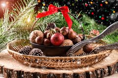 Christmas composition on wooden background. Christmas composition with pine cones, nuts and a Christmas tree on rustic wooden background Royalty Free Stock Images