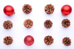 Christmas composition with pine cones and red christmas balls on white background stock photo