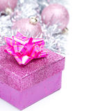 Christmas composition with pink gift box and baubles,  Stock Photo