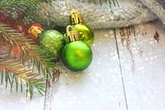 Christmas composition, postcard. Green Christmas balls close-up on the background of old white boards. royalty free stock photography