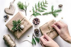 Christmas composition for the preparation for the New Year. Master class on gift wrapping in Eco-style. Top view Stock Images