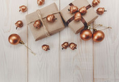 Christmas composition.Present boxes with string and silk twine and craft paper,golden acorns and balls.White wooden table stock photos