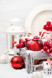 Christmas composition with red apples, balls, cinnamon, snow and Royalty Free Stock Photography