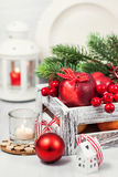 Christmas composition with red apples, balls, cinnamon, snow and Royalty Free Stock Photos