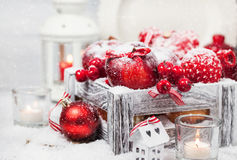 Christmas composition with red apples, balls, cinnamon, snow and Stock Images