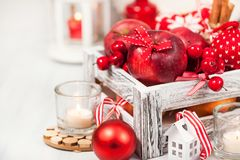 Christmas composition with red apples, balls, cinnamon, snow and Stock Photography