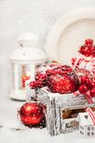 Christmas composition with red apples, balls, cinnamon, snow and Royalty Free Stock Image