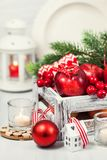 Christmas composition with red apples, balls, cinnamon, snow and Royalty Free Stock Photo