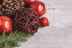 Christmas composition with red baubles and pine cones on wooden stock photos