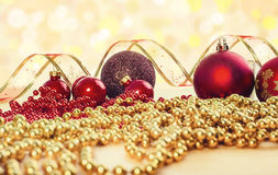 Christmas Composition. Red Baubles, Ribbon And Chain On Bright Background. Stock Images